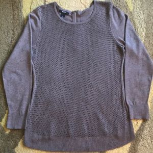 A grey sweater with sequins on the front